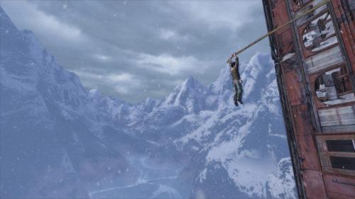 Nathan appeso sul vuoto - Uncharted.
